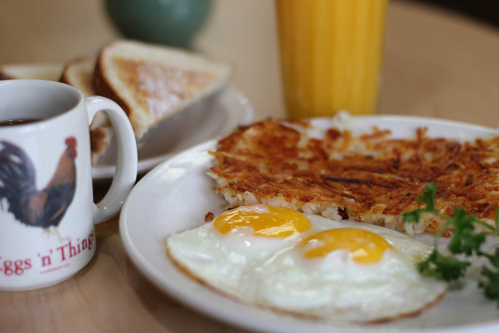 Eggs, hash browns, coffee, toast and Orange Juice