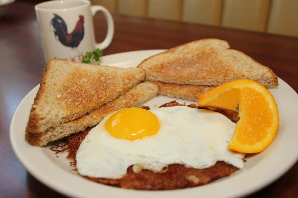 Early Bird Special with Corned beef hash, egg and toast